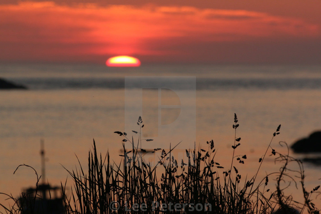 """Sunset over the sea"" stock image"