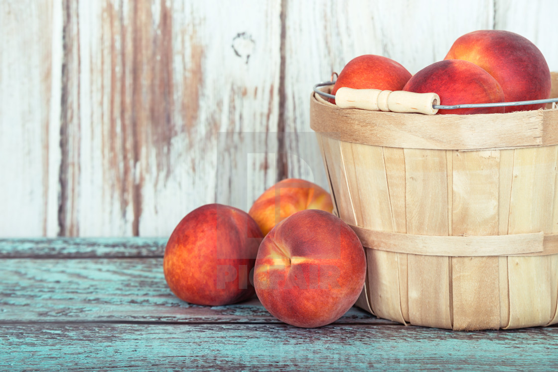 """""""Fresh peach fruits in a basket"""" stock image"""
