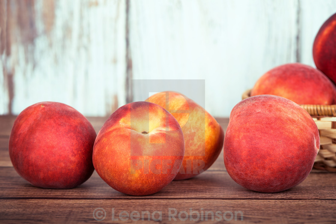 """""""Closeup of peach fruits on wooden table"""" stock image"""