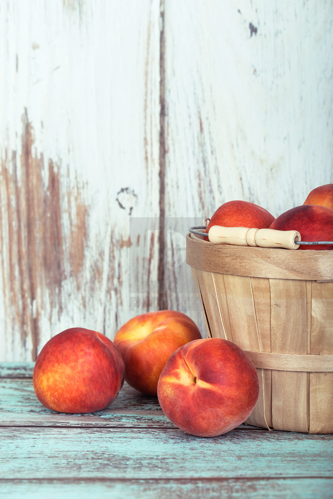 """Fresh peach fruits in a basket"" stock image"