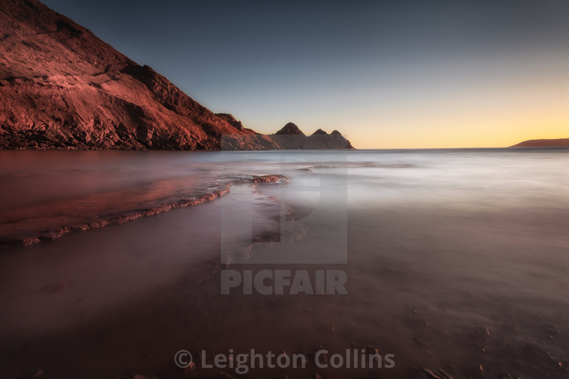 """Sunset at Three Cliffs Bay"" stock image"