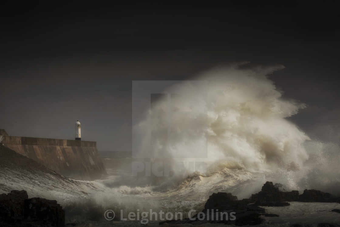 """Porthcawl lighthouse and storm wave"" stock image"