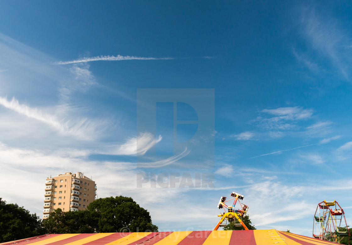 """""""Blue Skies over a Funfair's Tent"""" stock image"""