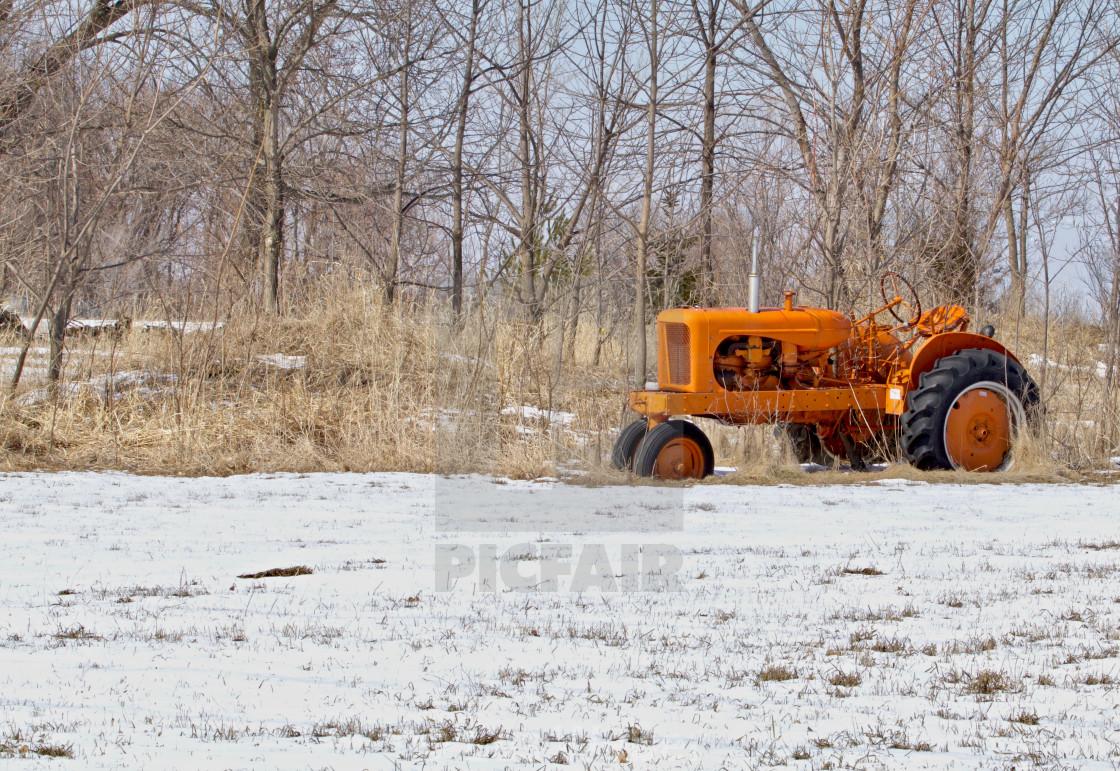 """Orange Tractor in the Snow"" stock image"