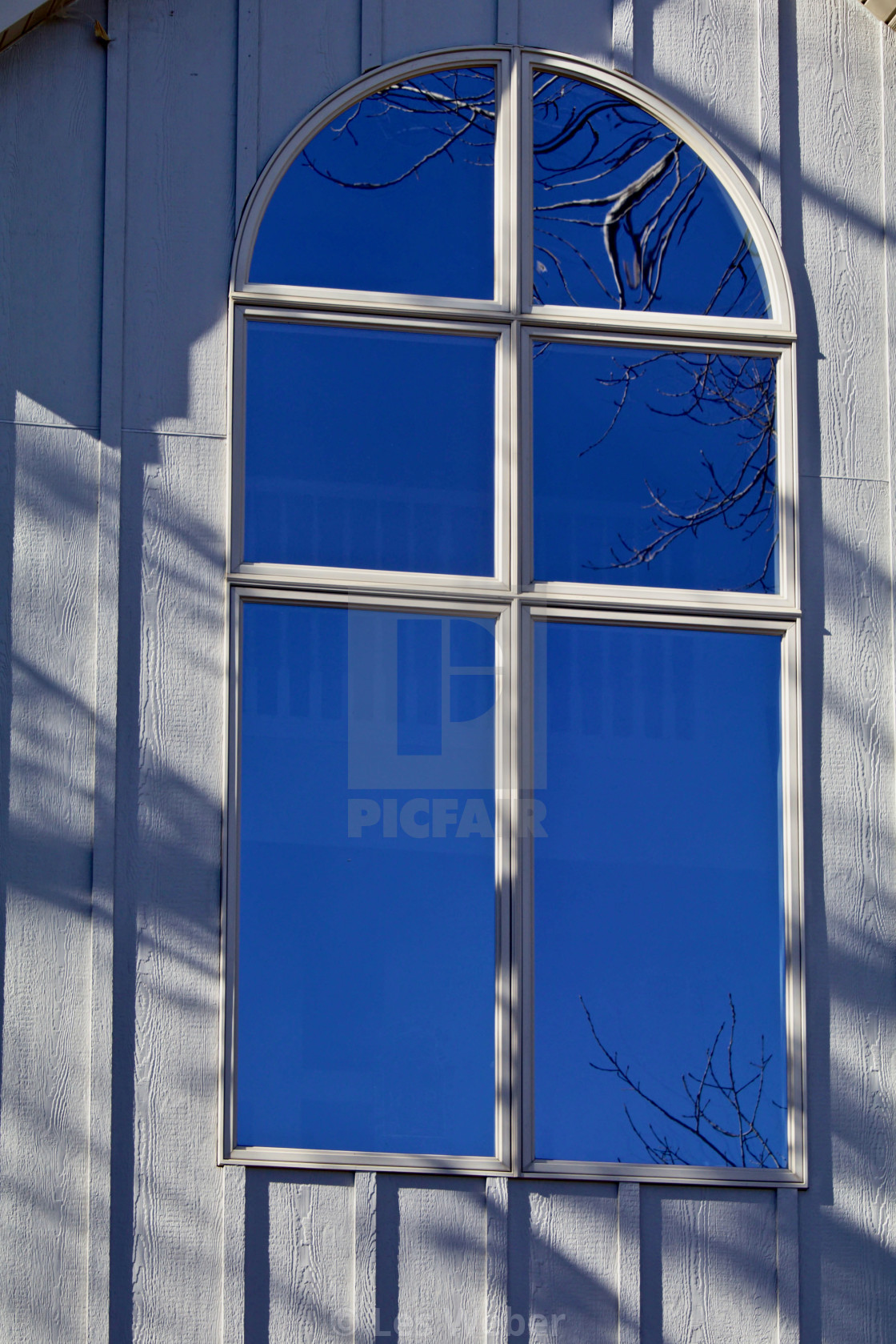 """Half Round Window Reflection"" stock image"