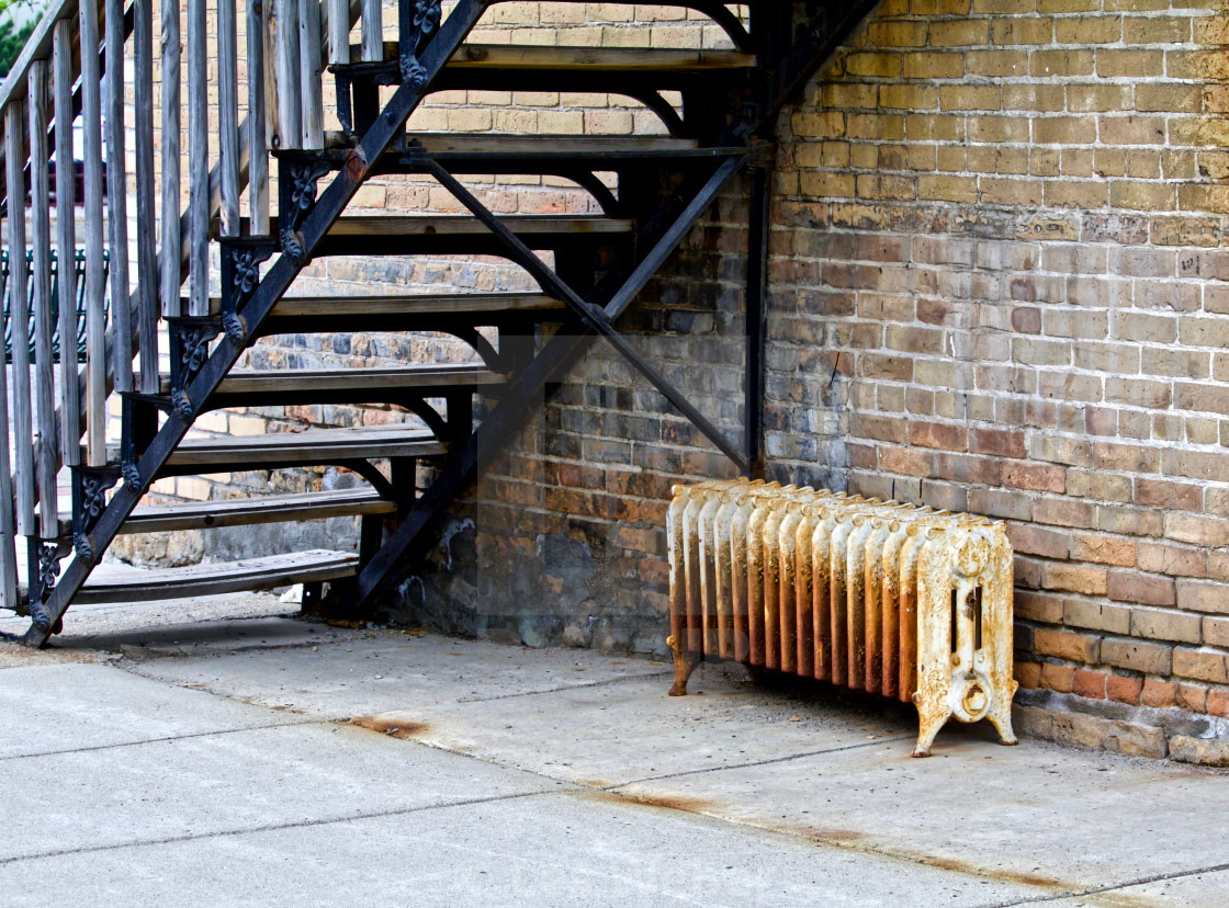 """Rusty Radiator Under the Fire Escape"" stock image"