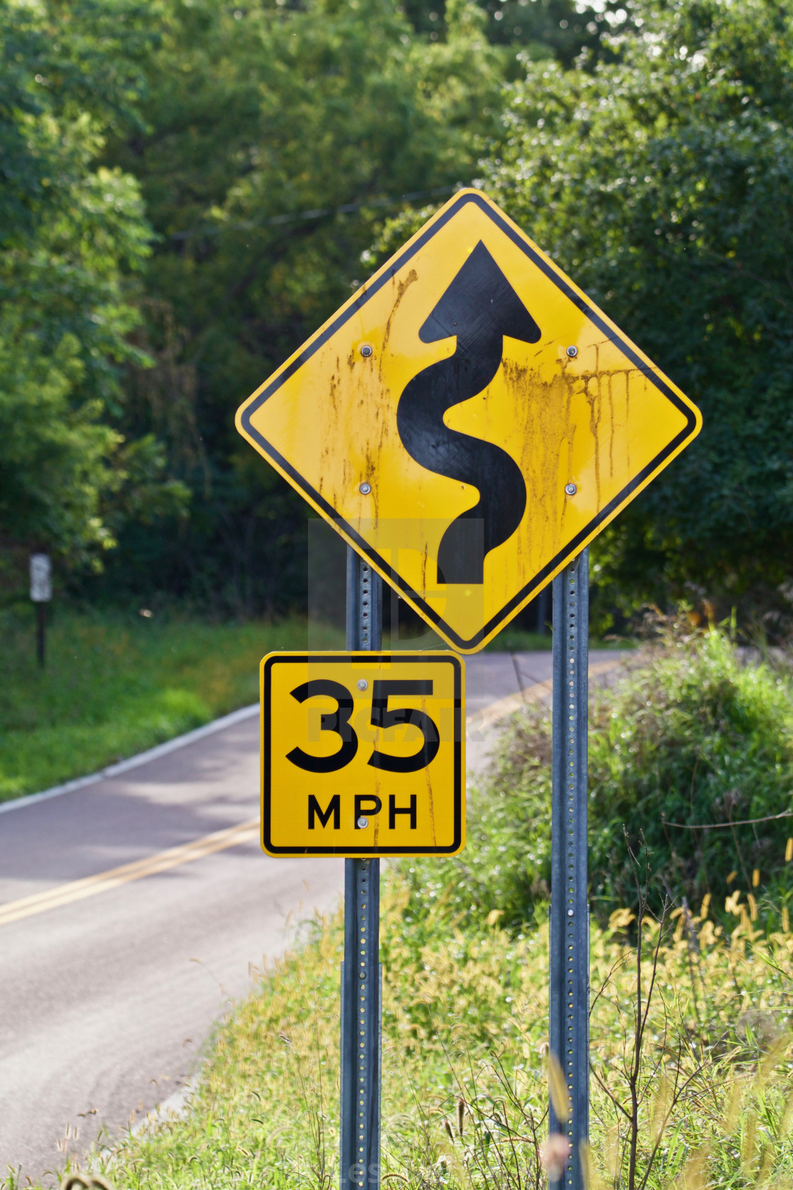 """35mph crooked road sign"" stock image"