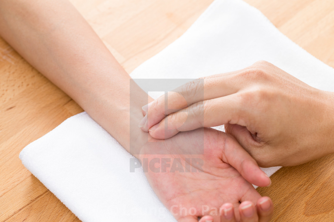 """Pulse diagnostic on hand"" stock image"