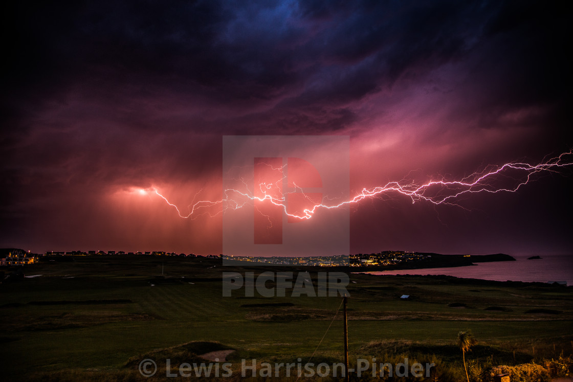 """Lightning Storm at Fistral Beach and Newquay Golf Course"" stock image"