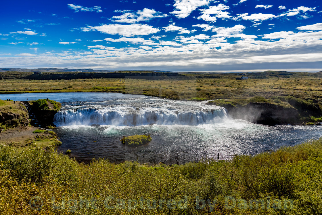 """Iceland, waterfall and a fisherman fishing in the river"" stock image"