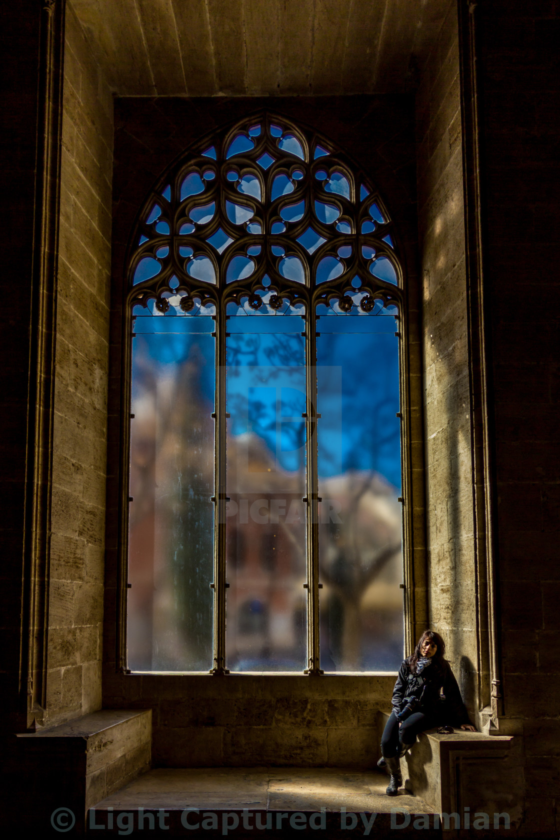 """Traveler girl in front of a beautiful church window in Valencia"" stock image"