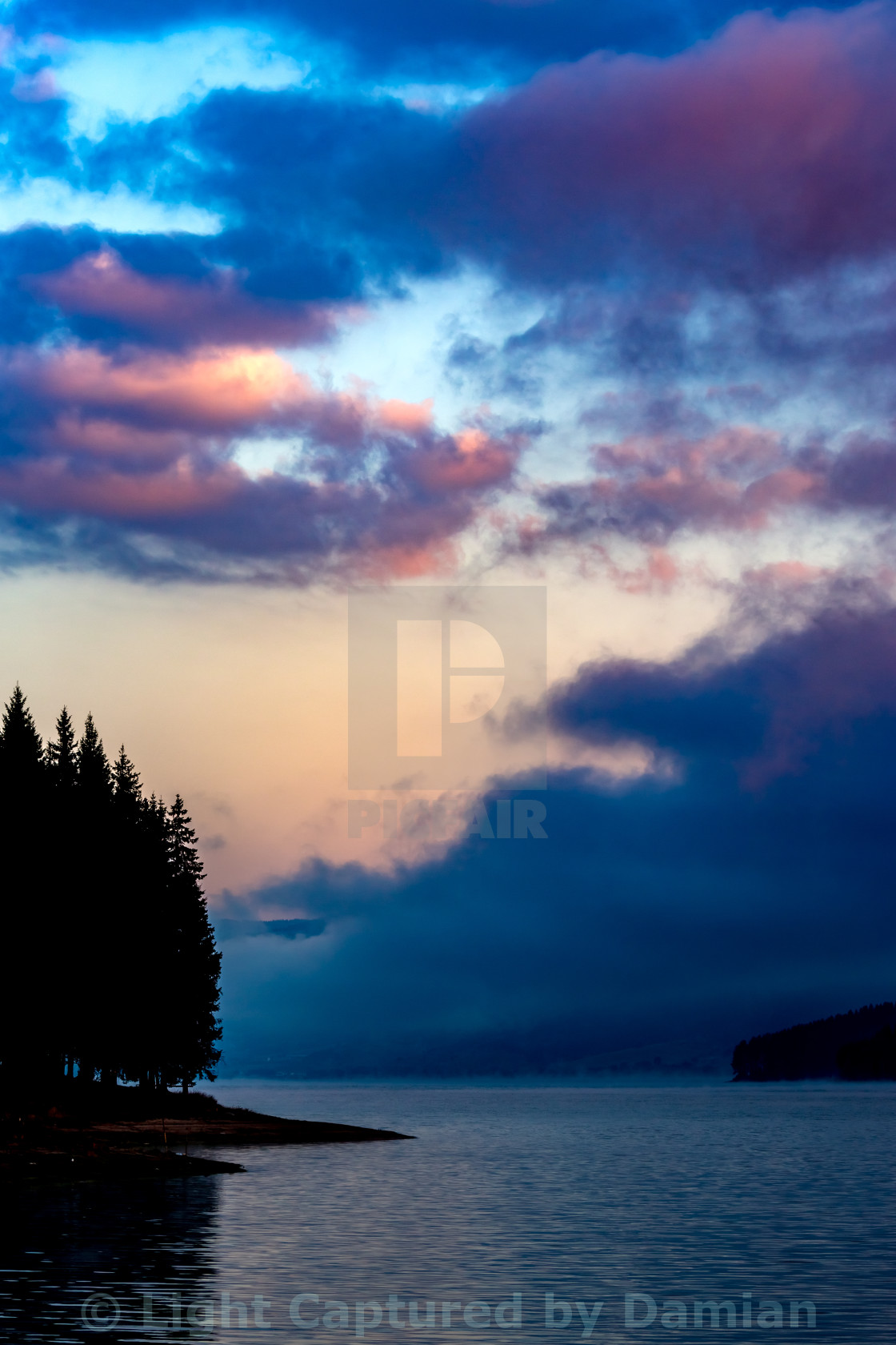 """Morning colorful clouds above the calm waters of the lake"" stock image"
