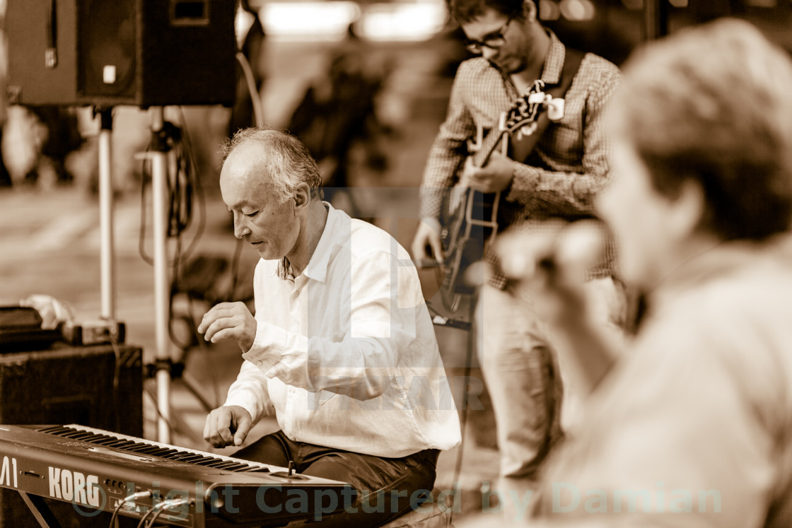 """Playing music on an electric piano at a free open street jazz concert"" stock image"