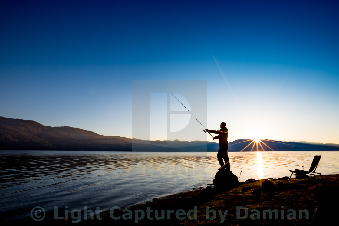 """Fishing in the calmness of the morning. Self portrait."" stock image"