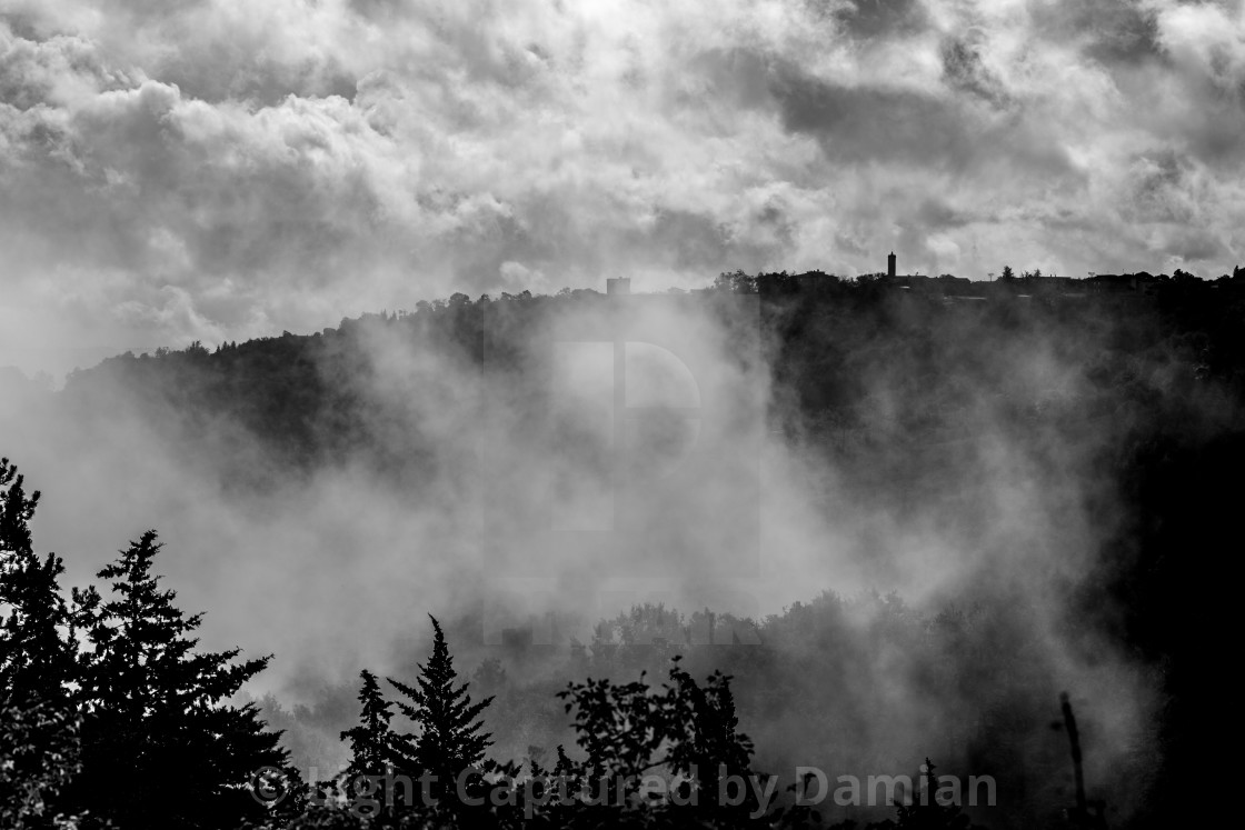 """""""Mist, fog and clouds above the old town."""" stock image"""