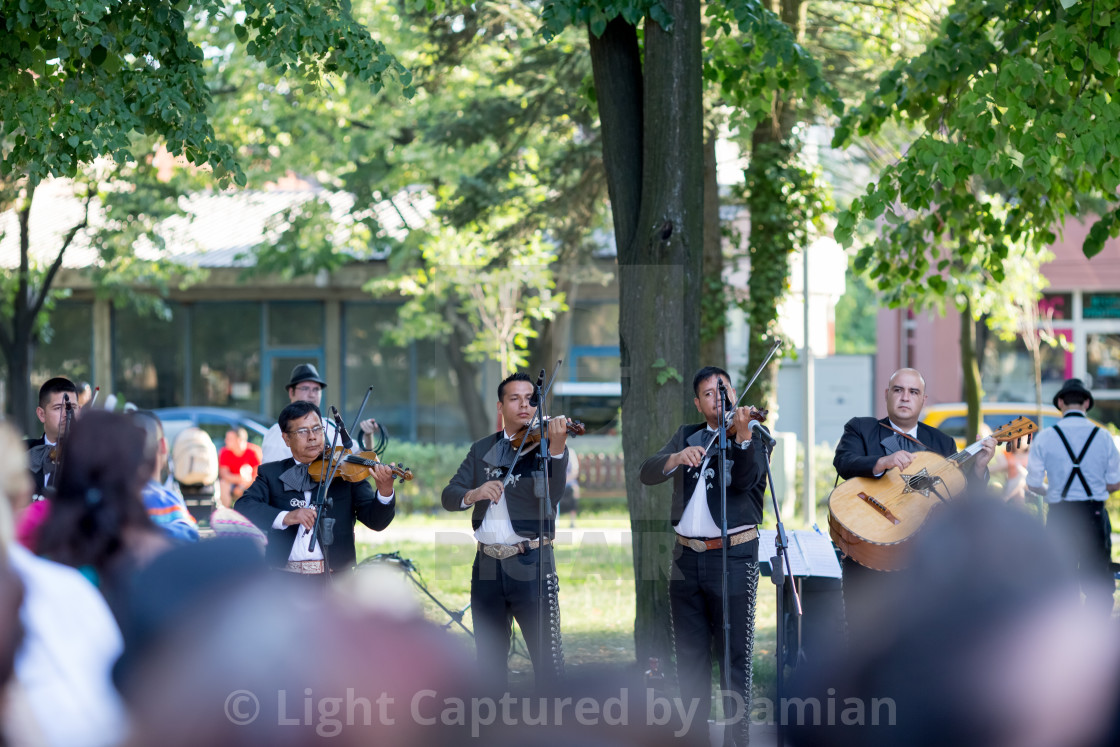 """Playing Latin music in the park"" stock image"
