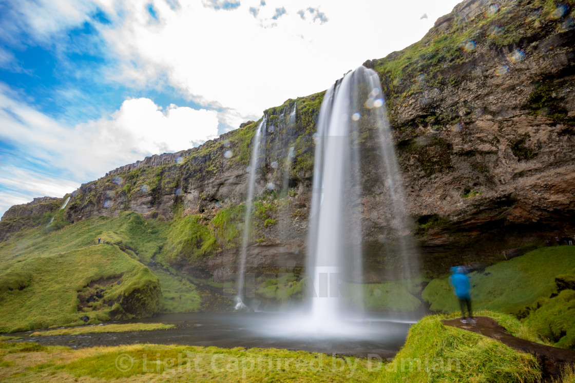"""""""The man and the waterfall"""" stock image"""