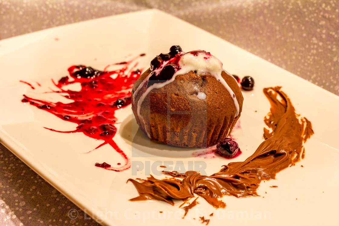 """""""Plate of muffin with a sprig of red currant ice cream with red jam and mint..."""" stock image"""