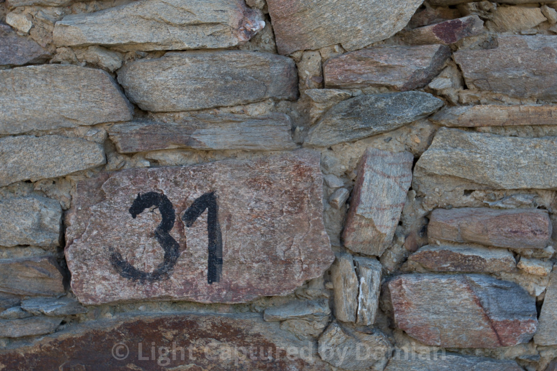 """""""Number thirty-one on a stone wall"""" stock image"""