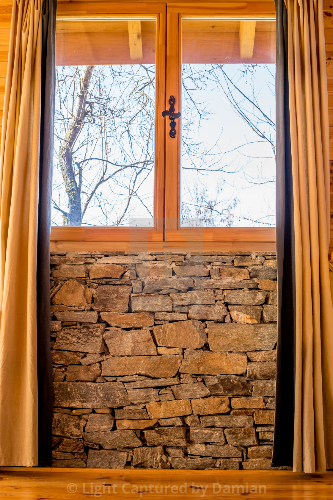 """""""Stone wall interior with window, curtains and tree"""" stock image"""