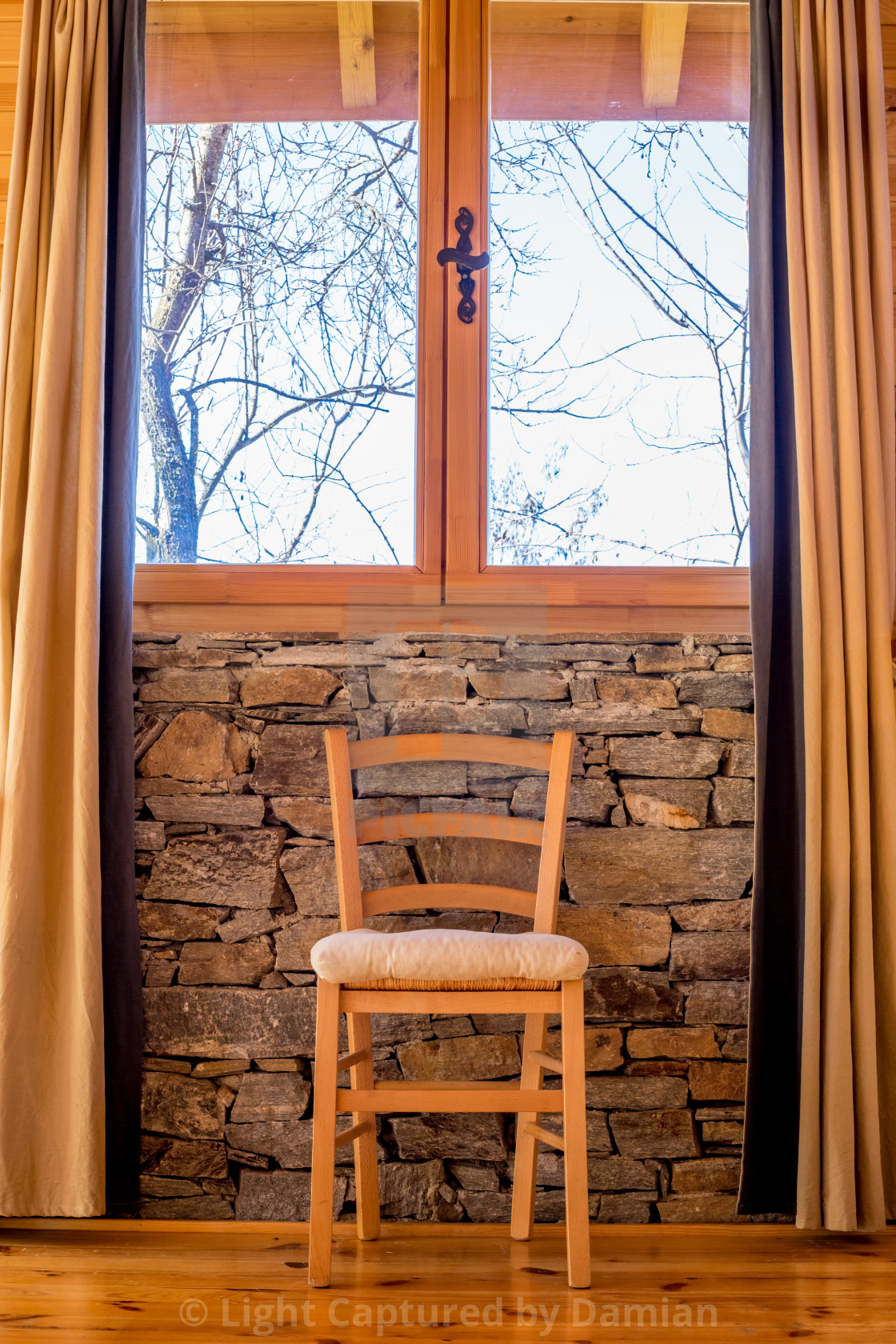 """""""Wooden chair in stone interior. Perspective view"""" stock image"""