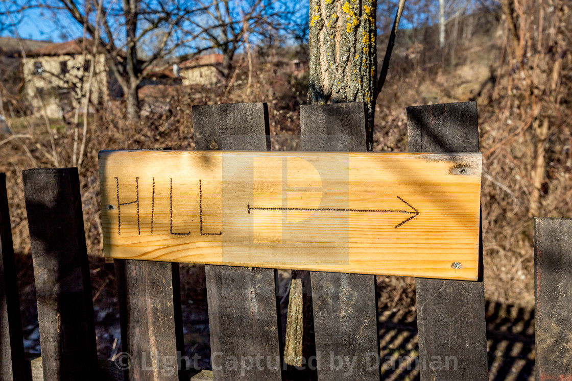 """Hill wooden sign with carved letters and arrow"" stock image"