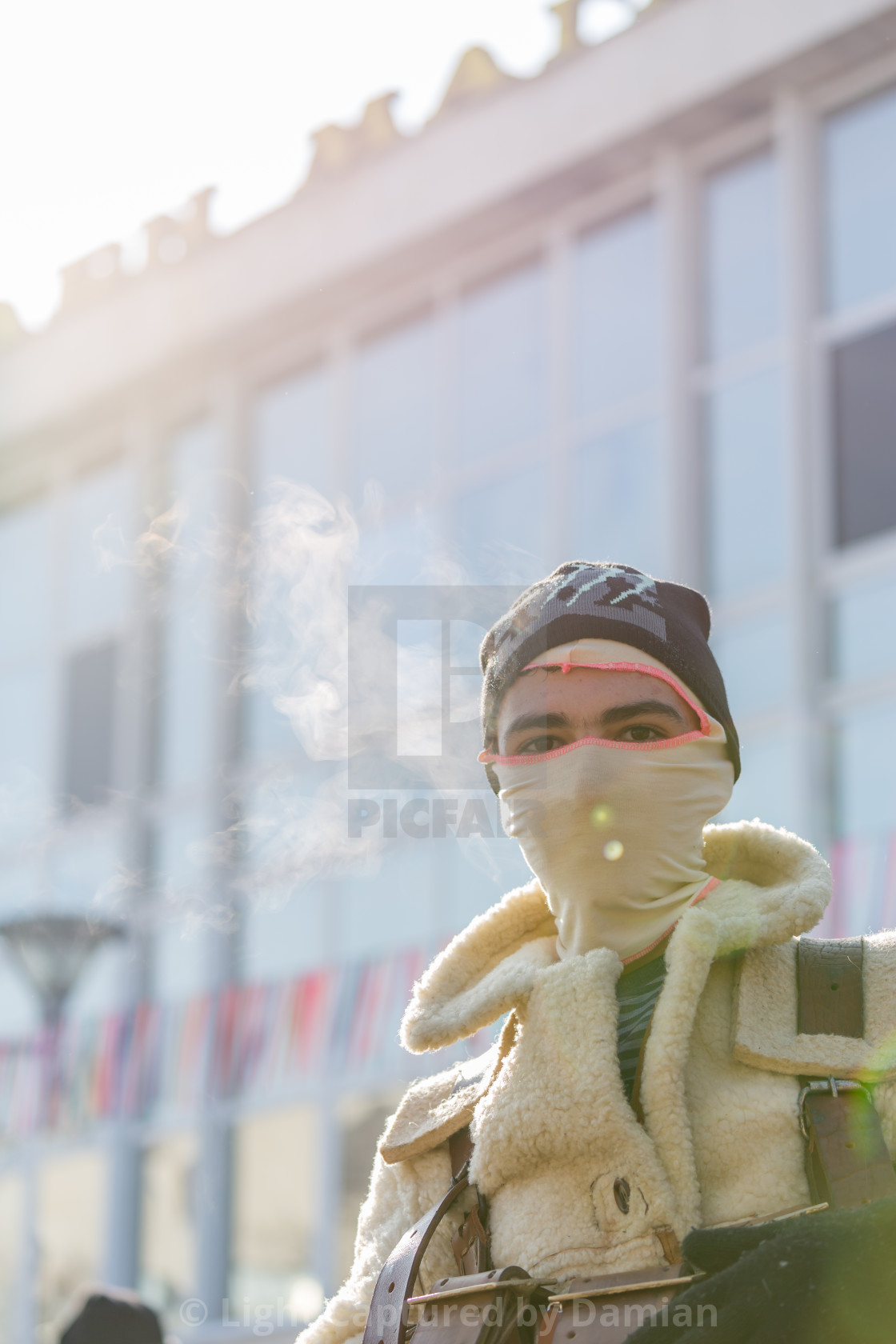 """""""He is hiding under the mask in the cold winter day"""" stock image"""