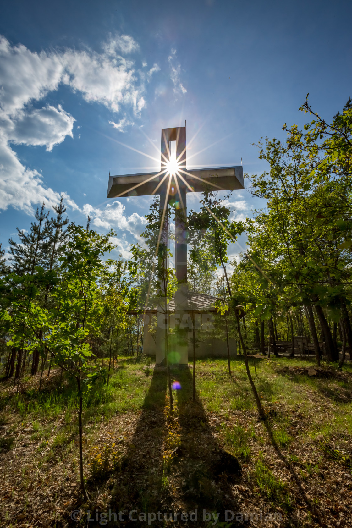 """Cross with a Bright Blue Sky and Sun"" stock image"