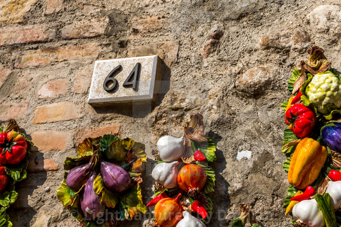"""""""Ceramic number sixty four 64 on a brick wall"""" stock image"""