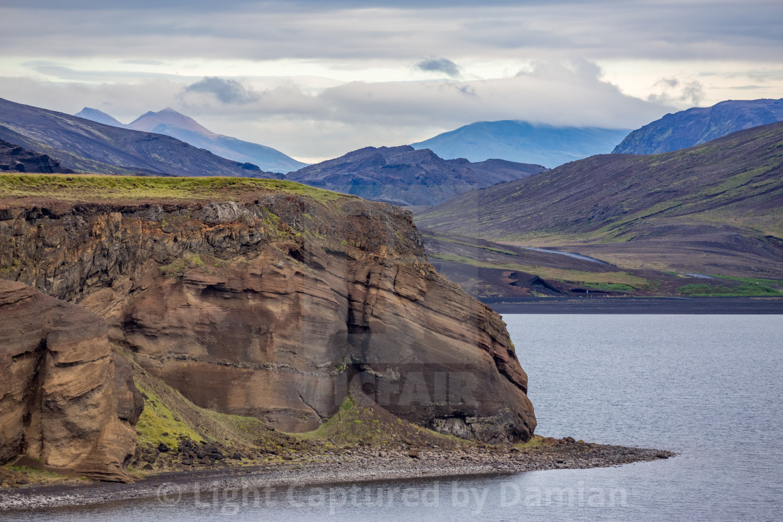 """View on the lake Kleifarvatn and black volcanic beach in Iceland"" stock image"