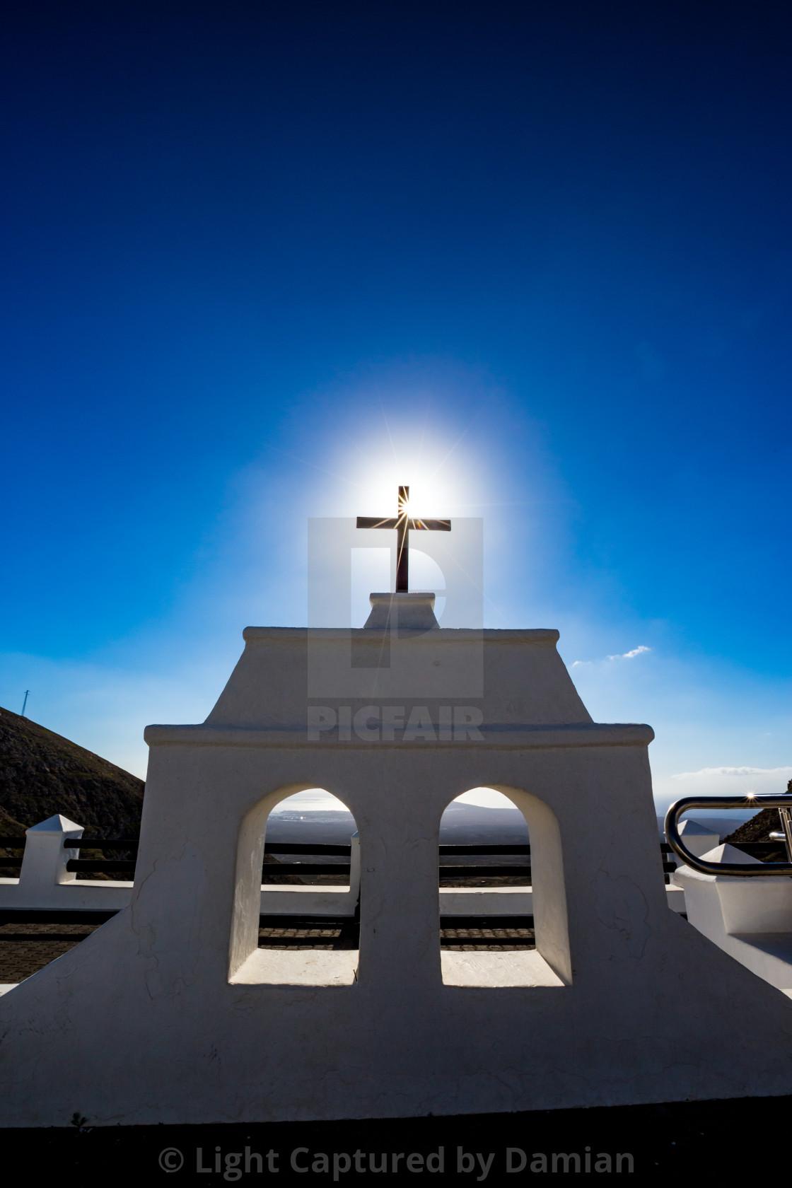 """Sun coming through black cross in Lanzarote, Spain"" stock image"