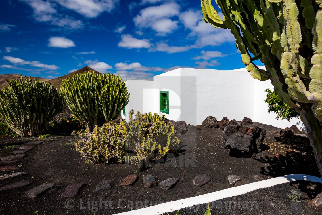 """Street view of beautiful Lanzarote garden house"" stock image"