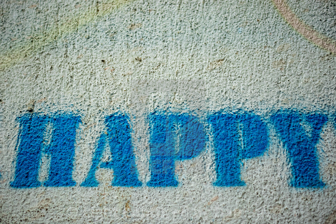 """Happy blue paint word graffiti on white wall"" stock image"