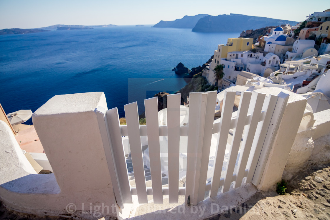 """Romantic white wooden door in Santorini, Greece"" stock image"