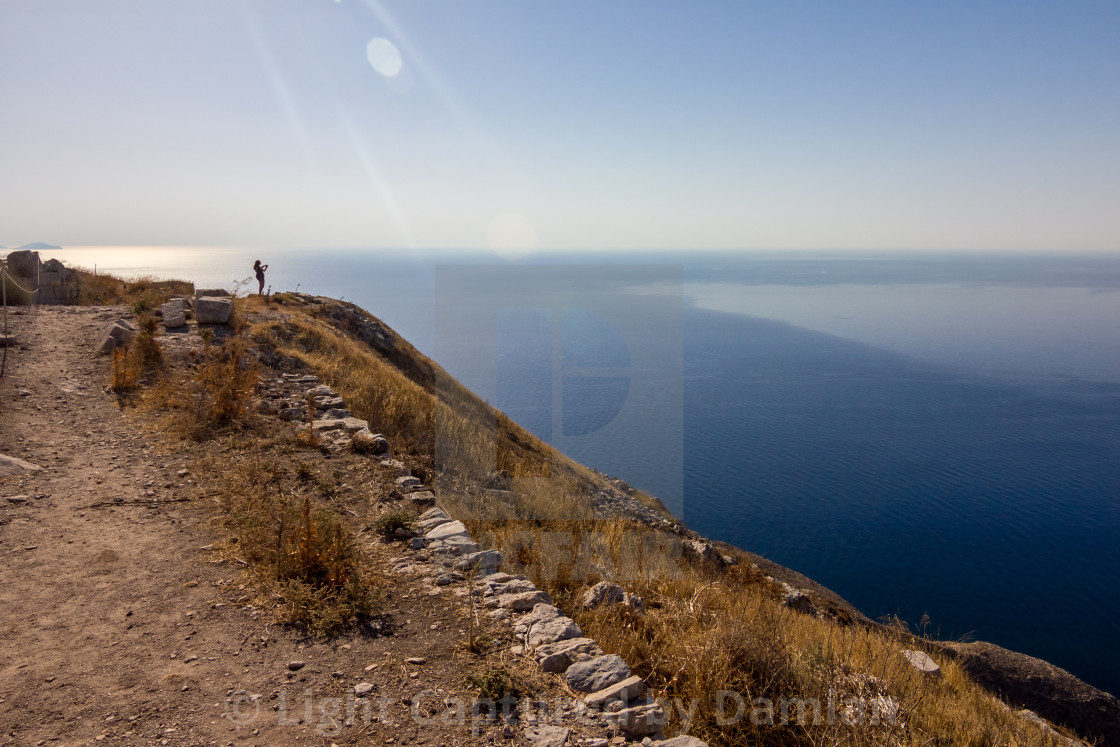 """Female tourist taking snapshots, Santorini, Greece"" stock image"