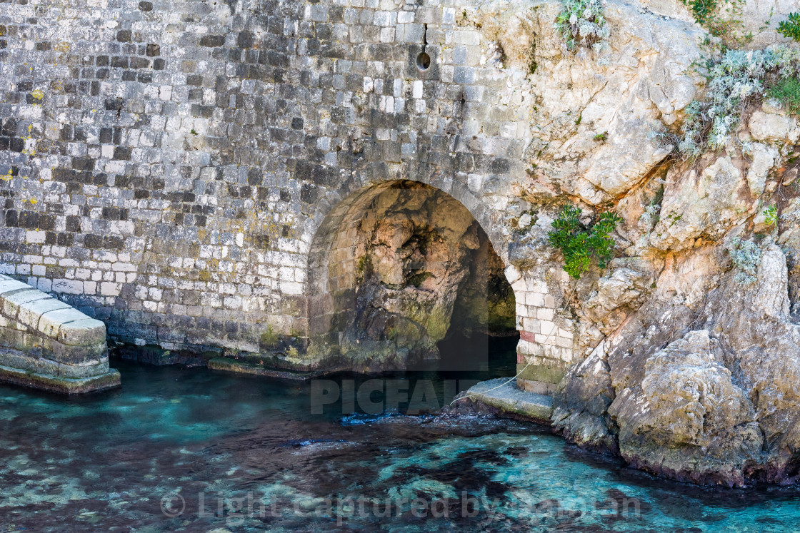 """Sea tunnel at the old castle of Dubrovnik, Croatia"" stock image"