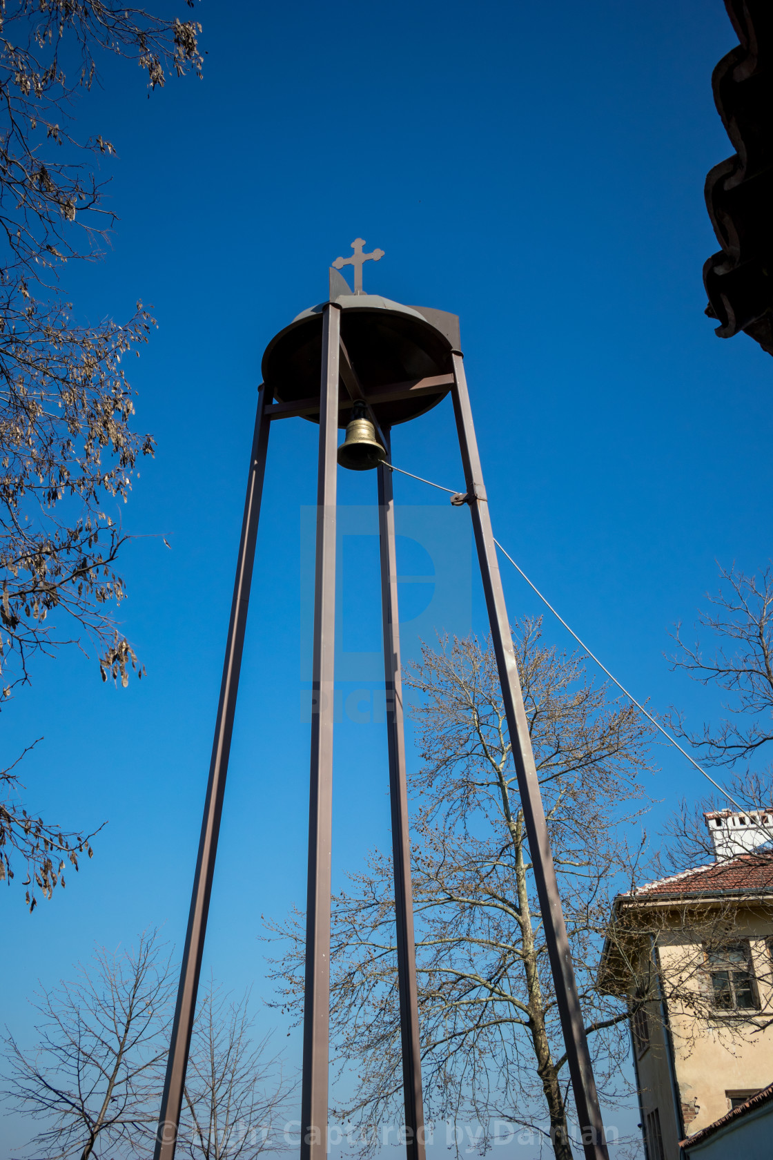 """Modern bell and cross tower of Batkun monastery"" stock image"