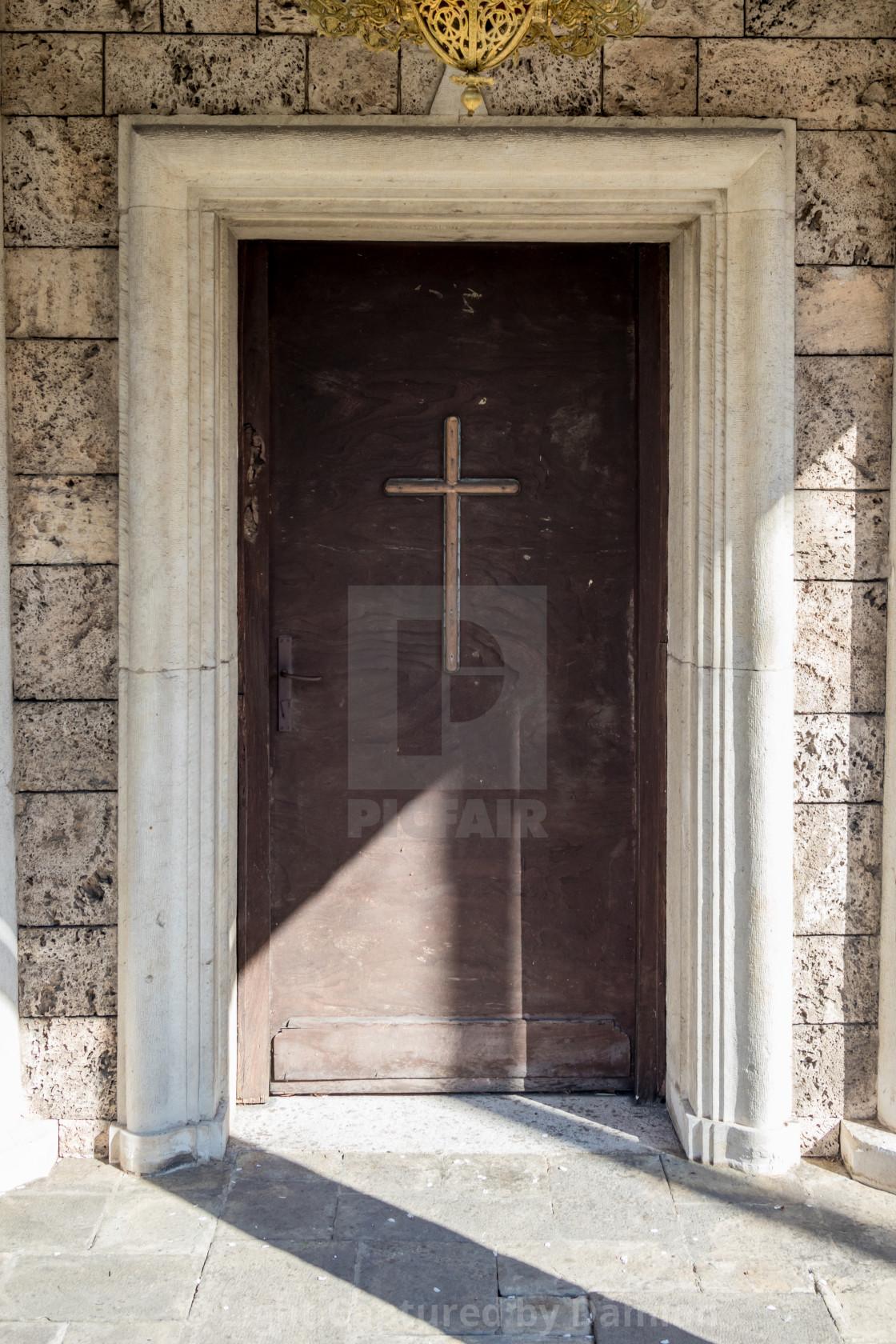 """""""Old wooden church door with cross Batkun monastery"""" stock image"""