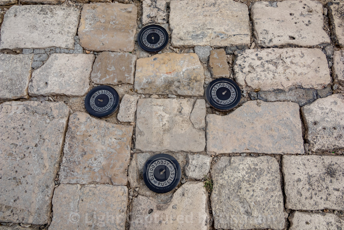 """Four small manhole covers in Matera"" stock image"