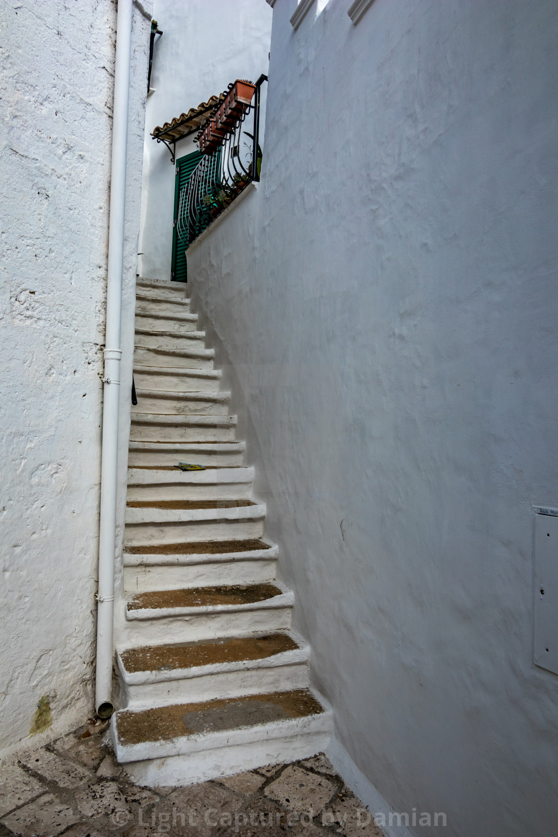 """White narrow Italian staircase"" stock image"