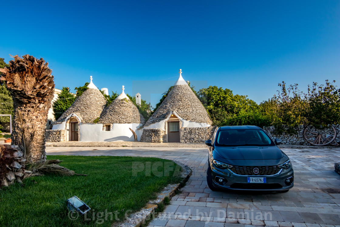 """New car and old architecture in Puglia, Italy"" stock image"