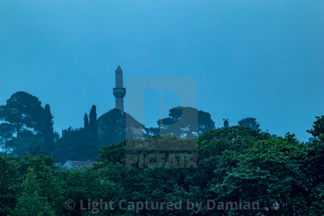 """Ioannina, Greece, mosque with trees and thick fog"" stock image"