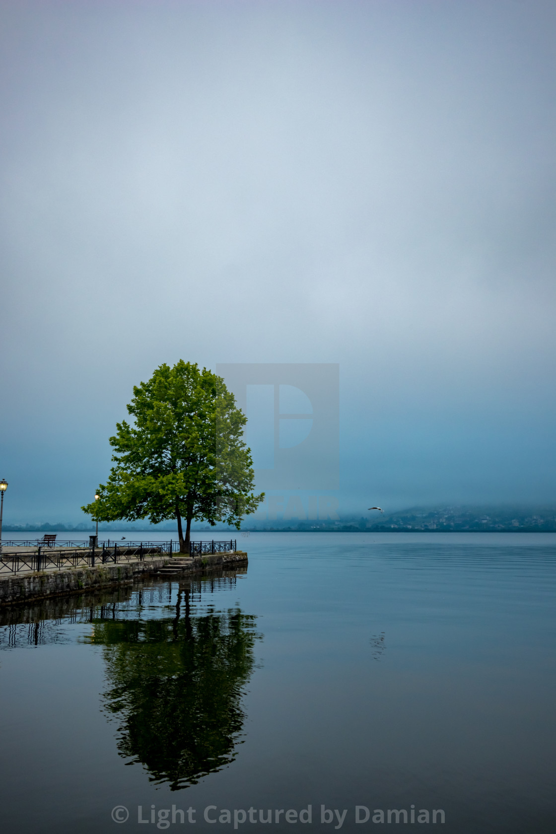 """Ioannina,Greece, lake morning with fog reflections"" stock image"