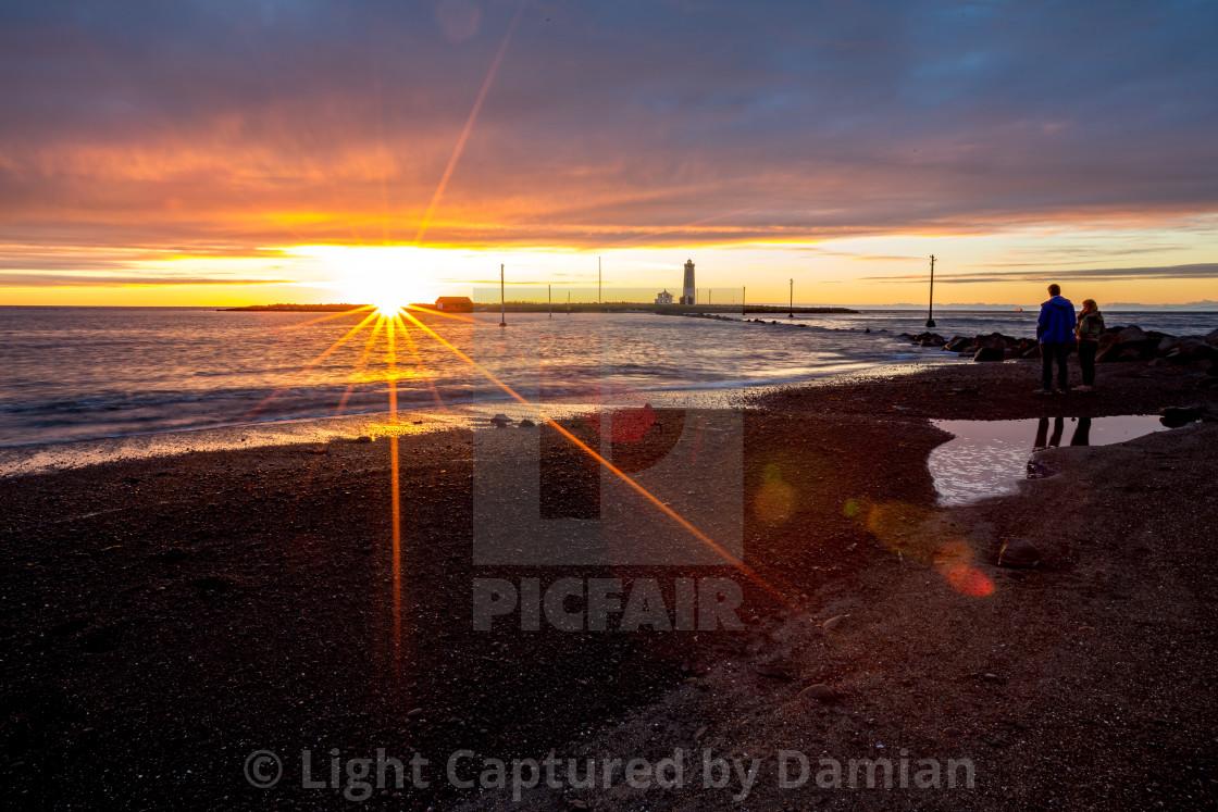 """Sunset over the sea, Reykjavik, Iceland"" stock image"