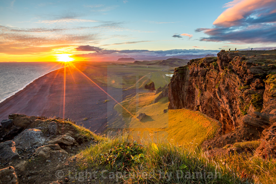 """Sunset over cliffs in Vik, Iceland"" stock image"