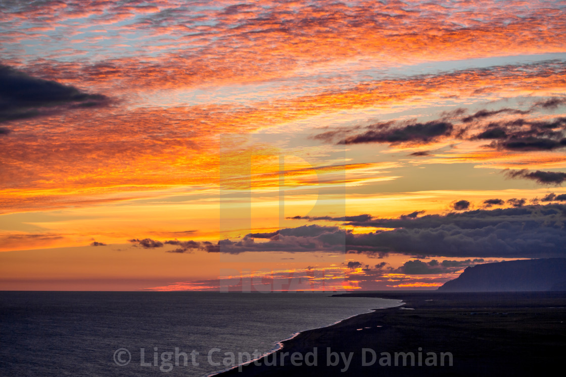 """""""Sunset sky as seen from lighthouse of Vik, Iceland"""" stock image"""