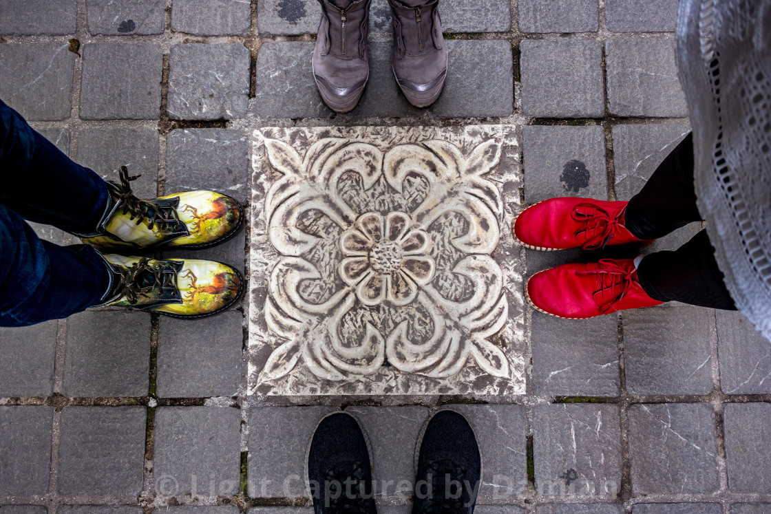 """Four pair of shoes and typical floor tile"" stock image"