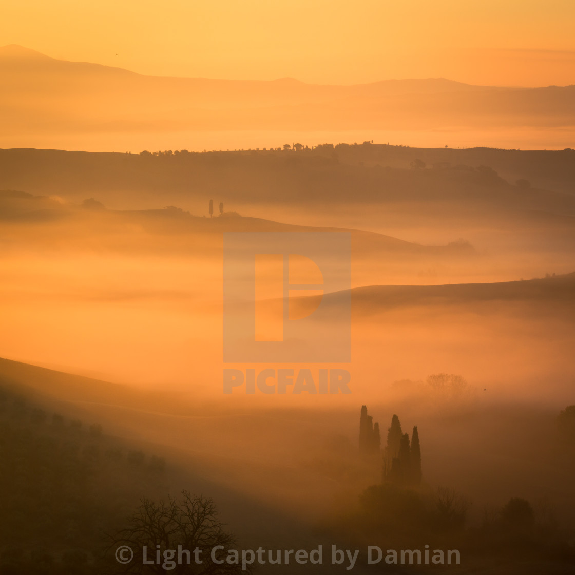 """Sunrise at San Quirico d'Orcia"" stock image"