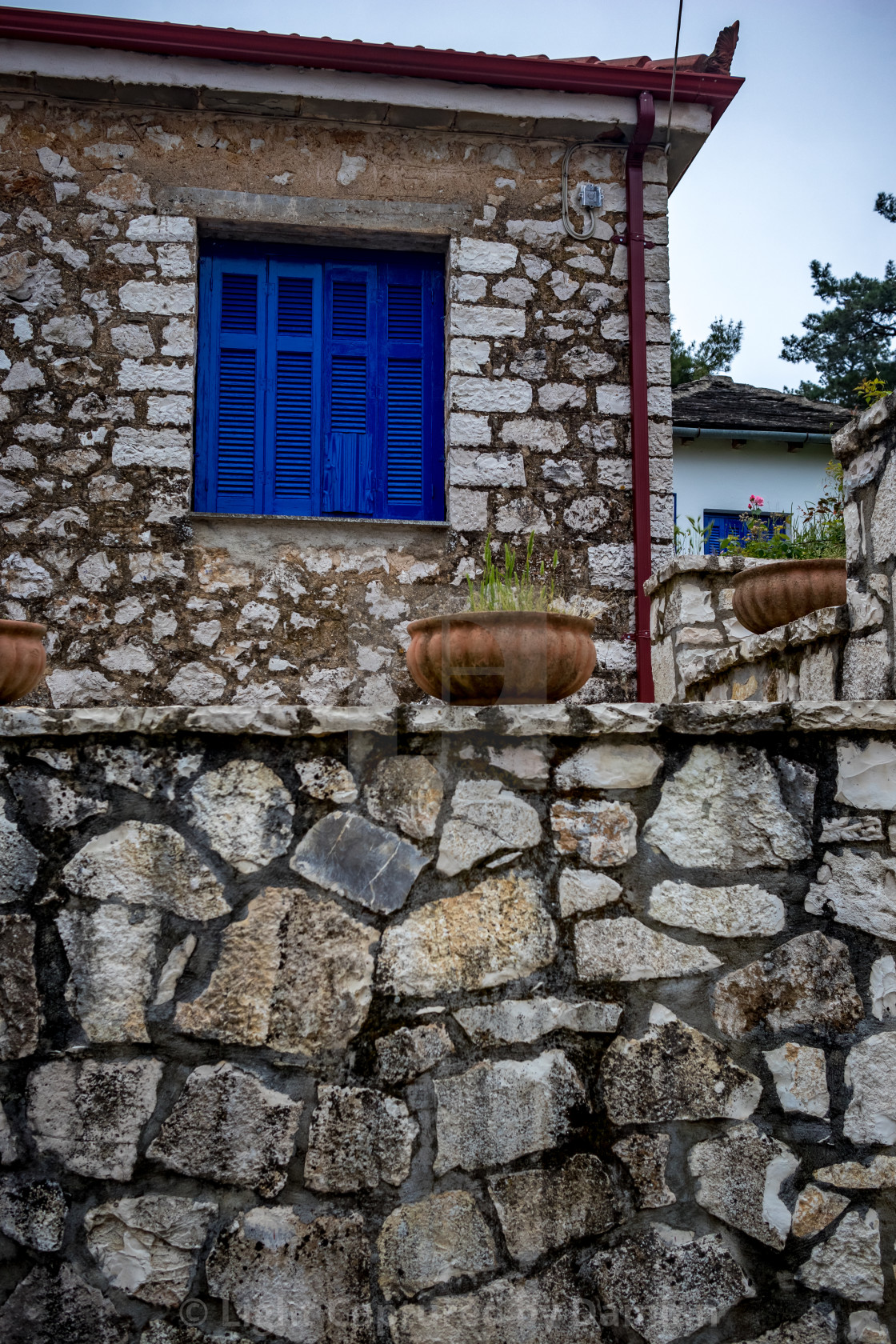 """Street view, blue window, Ioannina island, Greece"" stock image"