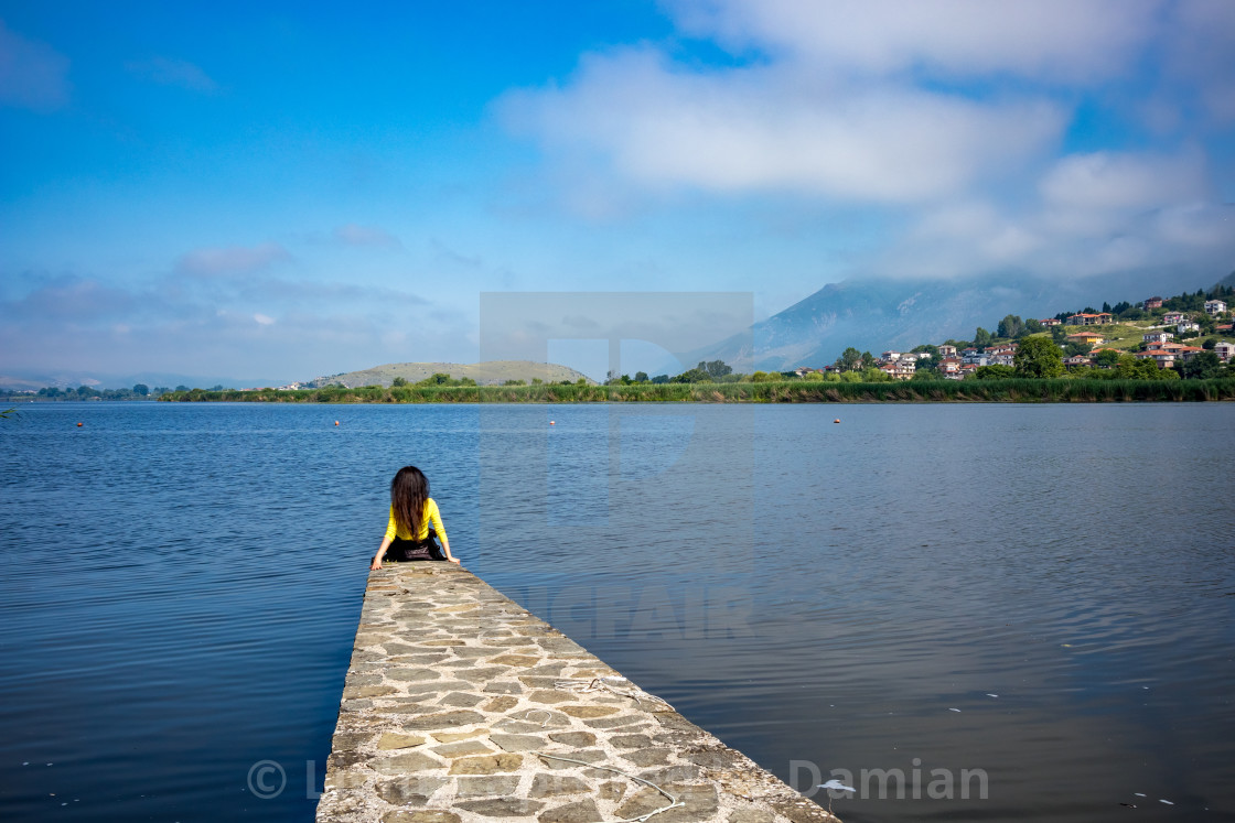"""Girl with long hair at Ioannina Island, Greece"" stock image"